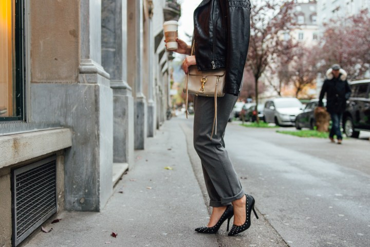 Rebecca Minkoff bag paired with high heels black and studded