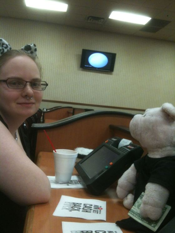Drinking a Hot Chocolate, While Apple Pig Holds The Tip For The Drink Lady We Were Waiting On.