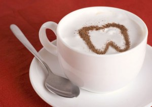 The Toothful Exchange Logo is a cup of coffee with a tooth in the cream.