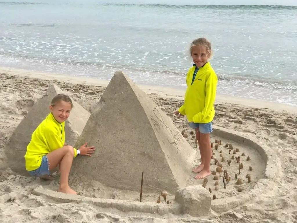 Building pyramids on building sandcastle Playa de Muro