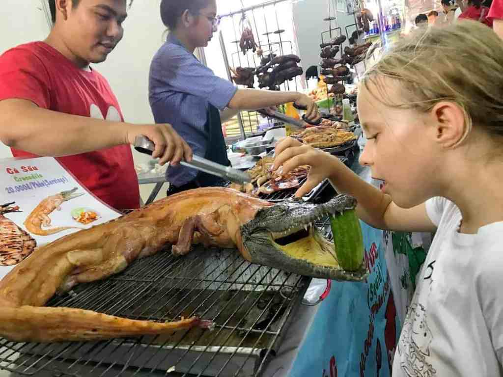 """Zozo and """"skinless"""" crocodile the travelling twins eat in southeast asia"""