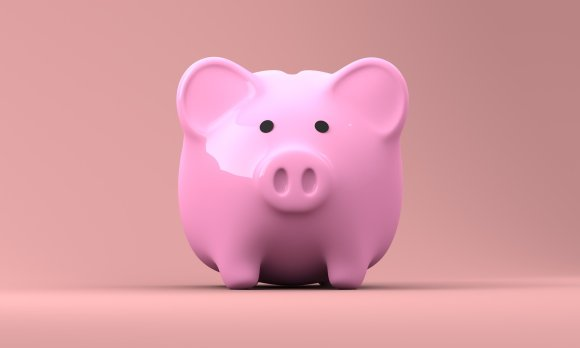 Save more money this Autumn using these tips. This picture is of a pink piggy bank, representing saving more money.