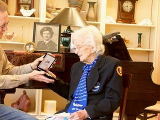 Lois accepts her Congressional Gold Medal from her son on March 12, 2010.