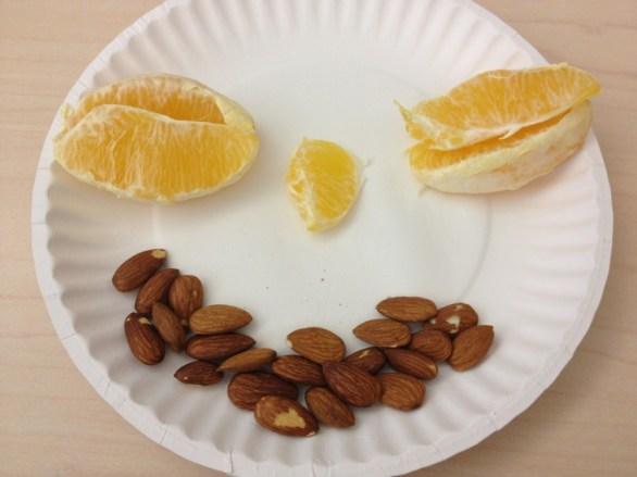 1/2 orange and almonds