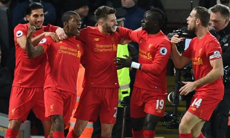 Liverpool's Dutch midfielder Georginio Wijnaldum (2nd L) celebrates with teammates after scoring the opening goal of the English Premier League football match between Liverpool and Manchester City at Anfield in Liverpool.