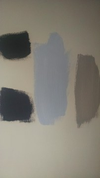 Took me a while to figure out the right paint colors. In the great paint debate, Distant Thunder by Behr (bottom left) and Silver Fox by Benjamin Moore (far right) won.