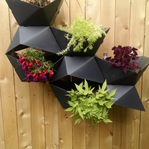 Modular planters on the left side of the fence.