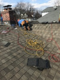 Our roofer sent us photos of the roof being torn off and a new one being put on.