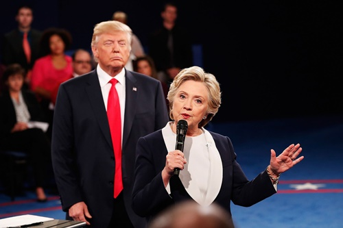 ST LOUIS, MO - OCTOBER 09:  Democratic presidential nominee former Secretary of State Hillary Clinton (R) speaks as Republican presidential nominee Donald Trump looks on during the town hall debate at Washington University on October 9, 2016 in St Louis, Missouri. This is the second of three presidential debates scheduled prior to the November 8th election.  (Photo by Rick Wilking-Pool/Getty Images) Getty Images North America  675358835 613698468