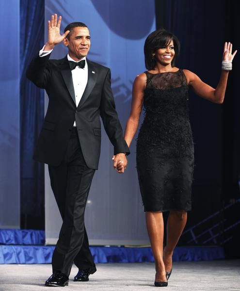 President Barack Obama and first lady Michelle Obama, wave as they arrive at the Congressional Black Caucus Foundation's Annual Phoenix Awards dinner, in Washington, Saturday, Sept. 26, 2009. (AP Photo/Manuel Balce Ceneta)