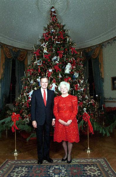 President and Mrs. Bush in front of the 1992 White House Christmas tree.