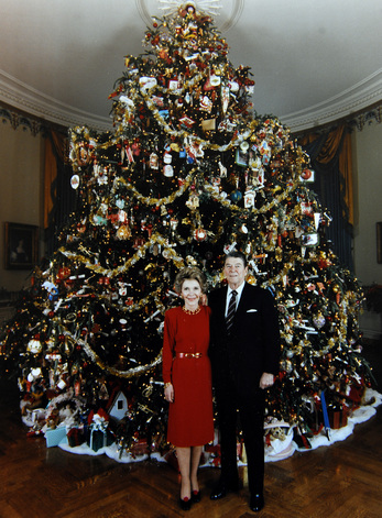 President Ronald Reagan and First Lady Nancy Reagan stand in front of the White House Christmas Tree in 1987