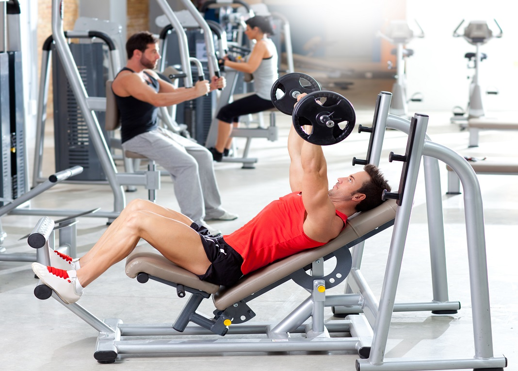 Workout Group With Weight Training Equipment On Sport Gym