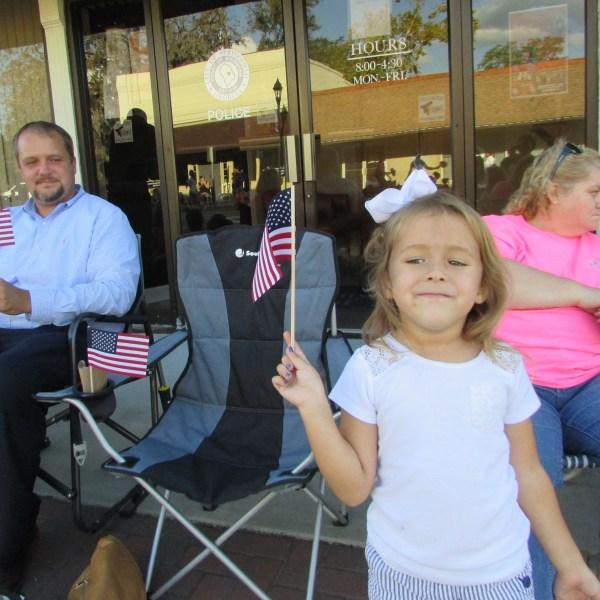 Girl waving flag