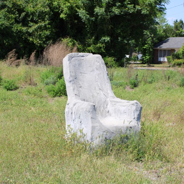 Cement chair on vacant lot