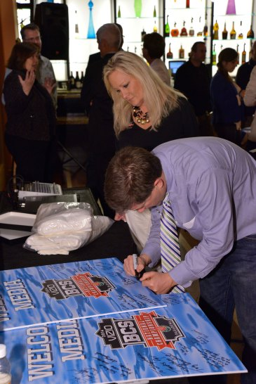 After the breakfast, Jon Wilner signed one of two appreciation posters the FWAA gave to Gina Lehe and Stephanie Montano of the Rose Bowl in appreciation for their service to the media during the Rose Bowl and the Bowl Championship Series title game. (Photo courtesy of Rose Bowl)