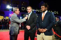 Brandon Scherff of Iowa and Malcom Brown of Texas being interviewed on the Red Carpet Show. Brown was an Outland finalist.