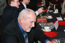 Former Nebraska Offensive Line Coach Milt Tenopir, recipient of the inaugural Tom Osborne Legacy Award for contributions to line play, signs autographs at the Outland Trophy presentation banquet on Jan. 15 in Omaha.