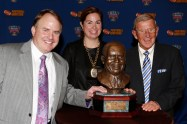 FWAA Eddie Robinson Coach of the Year Award winner Gary Patterson of TCU, his wife, Kelsey, and former Notre Dame coach Lou Holtz, a two-time winner of the Award, pose with the trophy on Jan. 10, 2015, in Dallas.