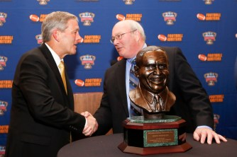 Iowa Coach Kirk Ferentz, winner of the Eddie Robinson Coach of the Year Award, shakes hands with Sugar Bowl CEO Paul Hoolahan. Photo by Melissa Macatee.