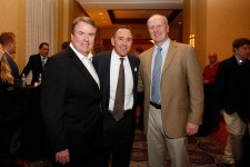 National Football Foundation President and CEO Steve Hatchell, FWAA member Andy Bagnato and Sugar Bowl COO Jeff Hundley at the Eddie Robinson Coach of the Year reception on Jan. 9 in Scottsdale, Ariz. Photo by Melissa Macatee.