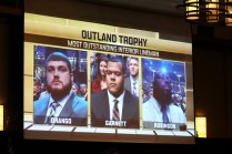 The three finalists for the 2015 Outland Trophy: Spencer Drango of Baylor, Joshua Garnett of Stanford and A'Shawn Robinson of Alabama appear on the big screen at the banquet. Photo provided by the Greater Omaha Sports Committee.