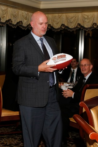 Joey Johnston of Tampa receives an FWAA commemorative football for service to the All-America Committee at the FWAA's Past Presidents Dinner on Jan. 6, 2017, in Tampa. Photo by Melissa Macatee.