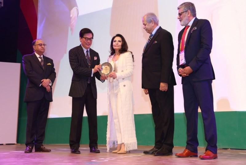 Dr Zeelaf Munir CEO EBM received the award on behalf of Khawar Masood Butt.