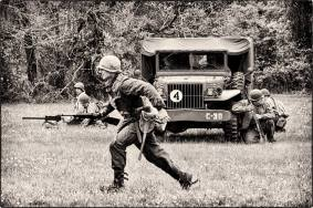 Bonder runs across the field after his squad begins taking fire. Credit: Unknown.