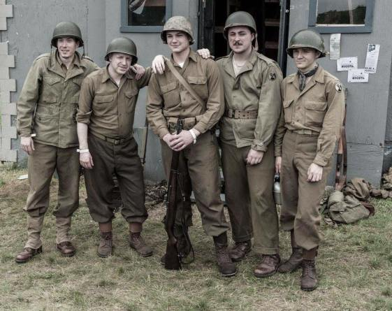 Members of the 94th pose in front of their home away from home at Reading Airfield. Credit: Melanie Krahling.