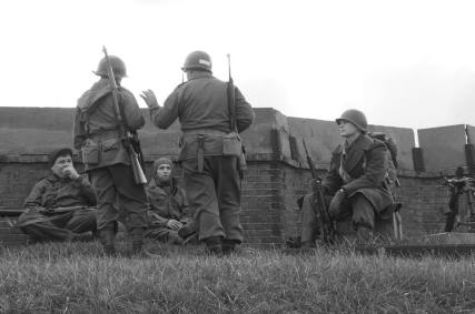 On watch, soldiers look out for evidence of Nazi patrols.