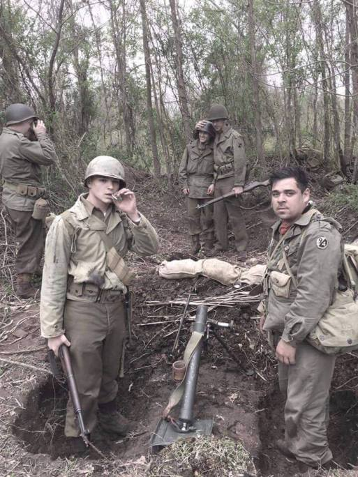 The 94th takes a break from digging one of their many foxholes. Credit: Jesse Campana.