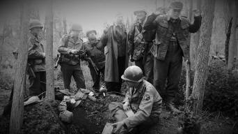 The 94th takes German prisoners after a small skirmish on a damp woodline. Credit: Brian Schade / Jesse Campana.