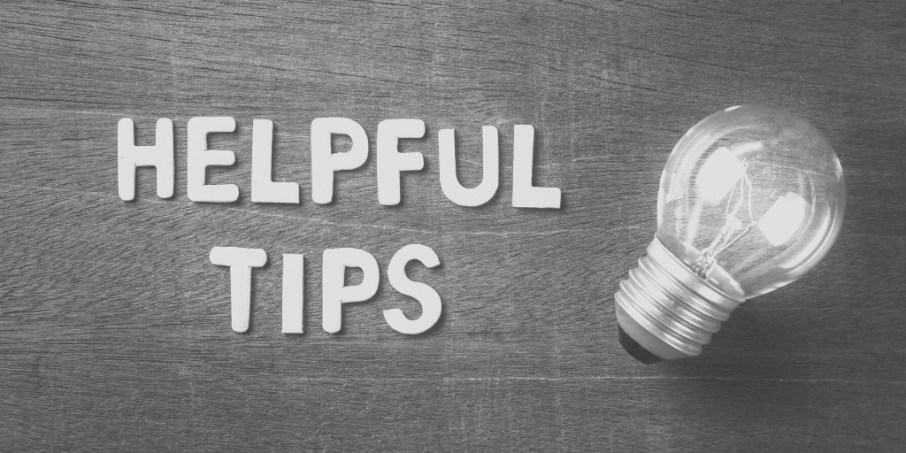 Words 'helpful tips' spelled out next to lightbulb