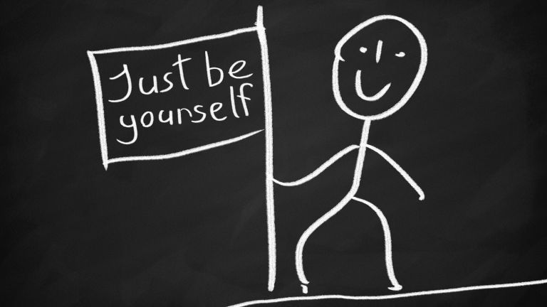 Stickfigure holding up a sign that says Just Be Yourself
