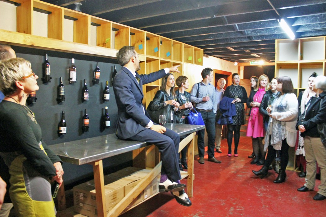 Maxwell James Mason showing guests in the cellar where the wine will go
