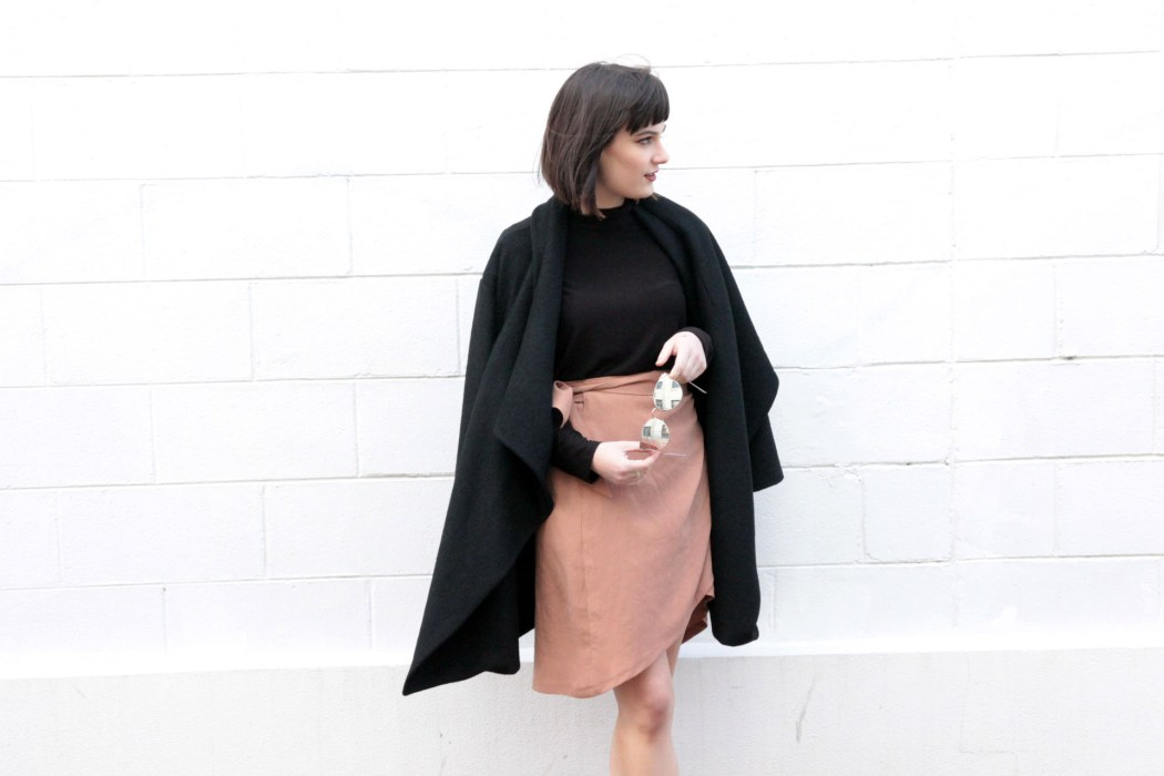 Kristen wears the 'Sunday Afternoon' wool jacket, the 'Drifter' black jersey top and 'The Fast One' caramel wrap skirt