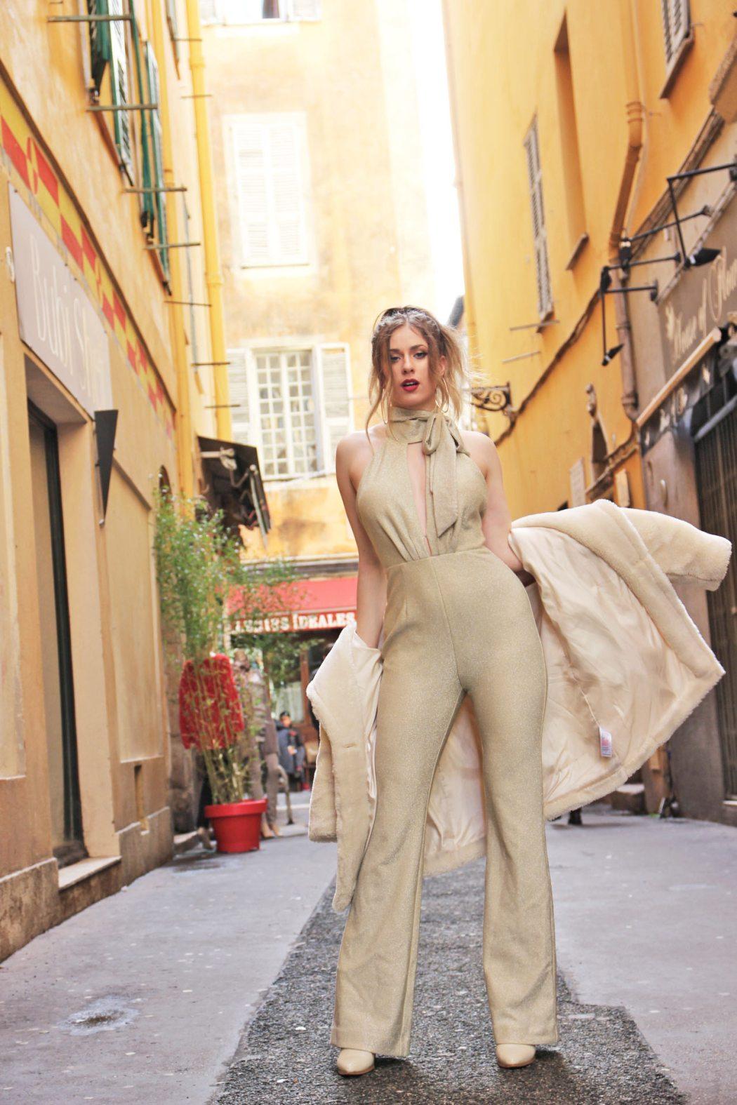 Melissa Zahorujko wearing Georgy Collection Hera Jumpsuit in Gold