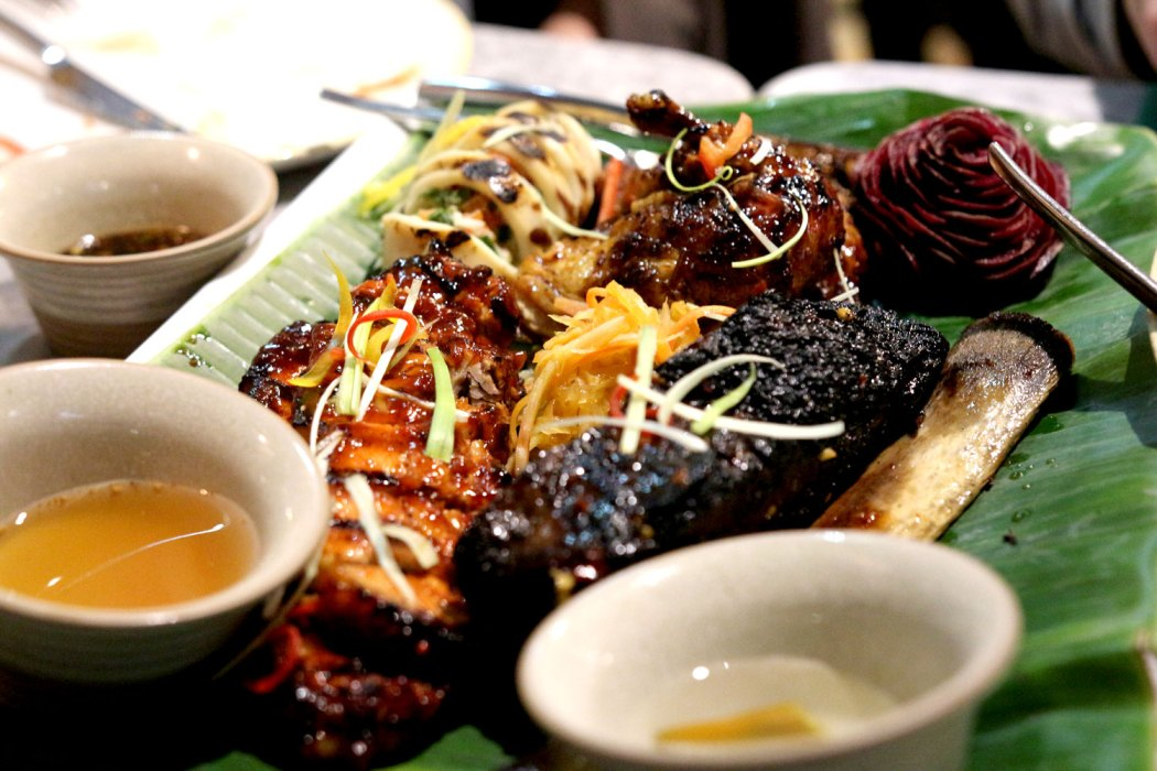 Platter of BBQ-ed meat and seafood at Romulo Cafe.