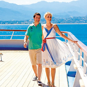 Young well dressed and attractive couple on a cruise ship