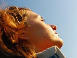 woman_eyes_closed_sun_rs