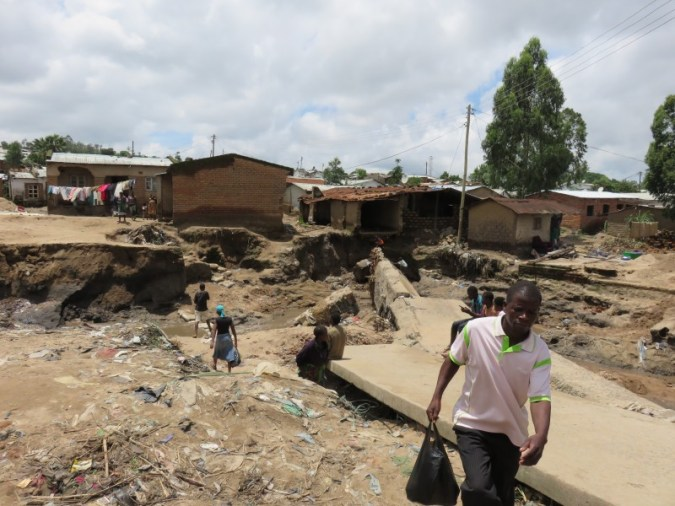Houses destroyed and a bridge washed away in Blantyre's Ndirande Township. Pic by G Maotcha/TAP