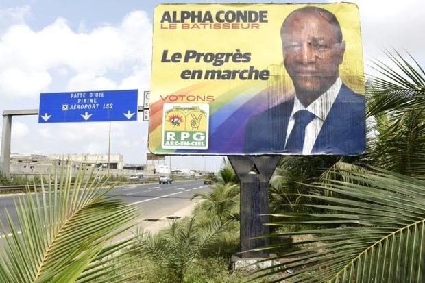 A vandalized billboard showing Alpha at the side of a highway in Dakar, on October 9, 2015 Seyllou Diallo, AFP  Read more: http://www.digitaljournal.com/news/world/tension-flares-in-guinea-ahead-of-presidential-poll/article/446088#ixzz3ongOMPiV