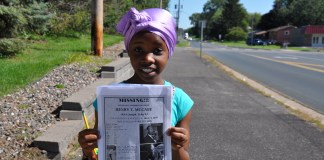 LaBelle Freeman, 10, from Brooklyn Center, searching for Henry McCabe. Photo: (c) The AfricaPaper/Issa A. Mansaray.