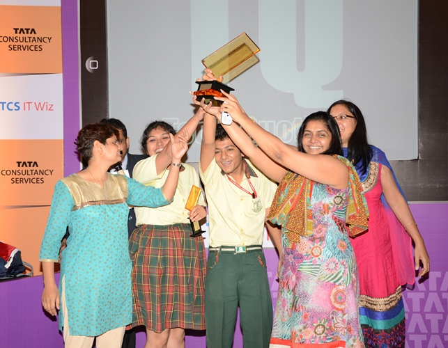 Winners with teachers with trophy of Ahmedabad regional round of TCS IT Wiz 2013