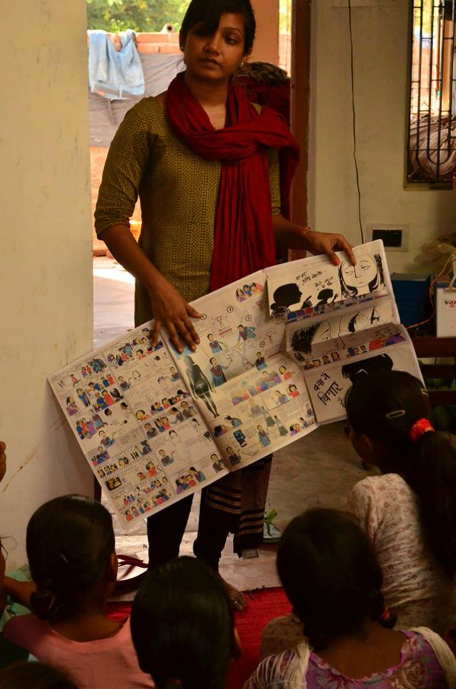 Menstrupedia A workshop conducted in rural Uttar Pradesh. Medavini Yadav showing the comic book to the girls.