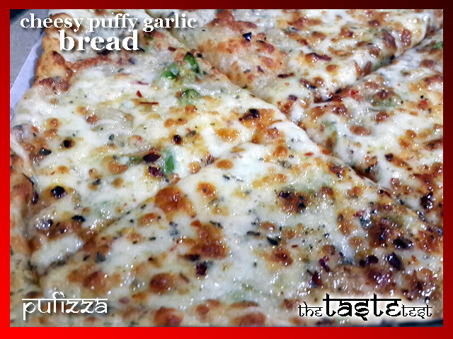 Cheesy puffy garlic bread only at Puffizza in Ahmedabad