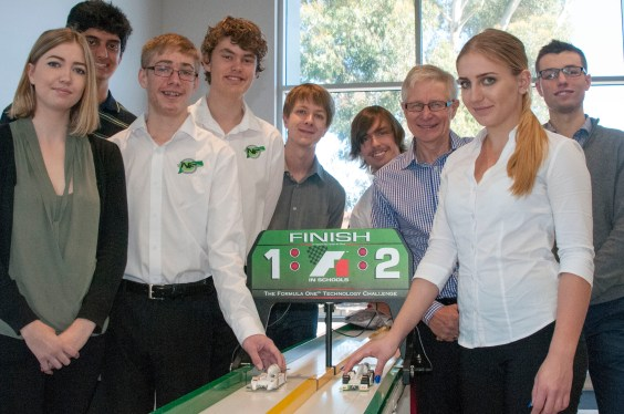 Stephen Read with students from past and current F1inSchools race teams. Jane Burton (extreme left) managed the team which won the World Championships in 2013. Nicole Kascak (right) has that responsibility at the 2016 F1inSchools World Finals in Texas