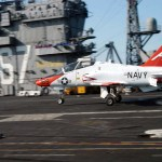 Lt.j.g. Julin Rosemand, assigned to Fixed Wing Training Squadron One (VT-1), completes a successful landing in a T-45C Goshawk aboard USS John F. Kennedy in 2004 (US Navy photo)