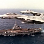 Fighter Squadron 14 (VF-14) F-14A Tomcat aircraft fly over the French aircraft carrier Foch (R 99) during a joint exercise between the FOCH and the aircraft carrier USS John F. Kennedy.